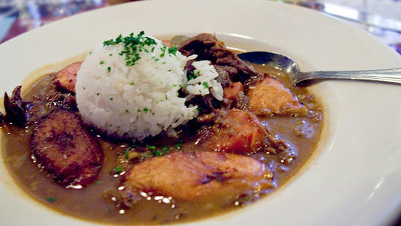Spicy coconut curried goat stew at Highland Kitchen