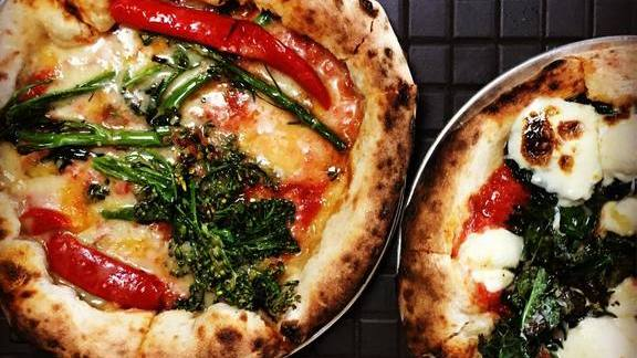 Wood-fired pizzas with red peppers, kale and mozzarella at Lodge Bread Co
