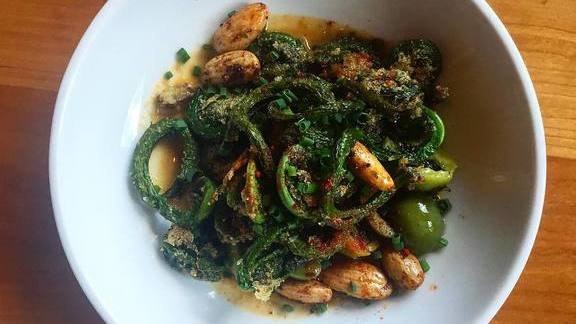 Fiddleheads, almonds, Spanish blue cheese fondue at Oleana