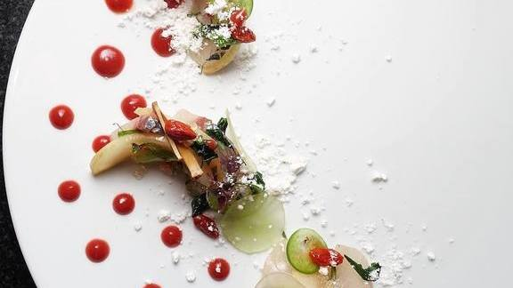 Chef Tony Messina reviews Shima aji sashimi with mala powder, smoked apple, and goji berry-red ginger vinaigrette at UNI