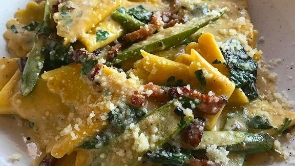 Corzetti with asparagus, bacon, and ramps at CAVATINA at Sunset Marquis