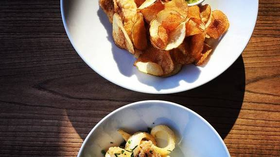 Fish and chips, homemade sour cream, and onion and fried calamari at Porto