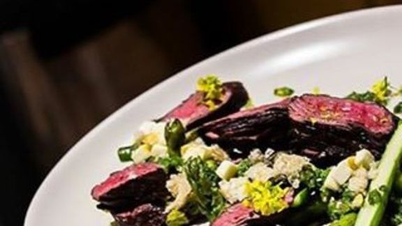 Hangar steak, mesquite, asparagus, parsley, salsa verde, and caramelized queso at