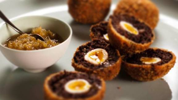 Morcilla scotch eggs, green pepper relish at The Modern Pantry