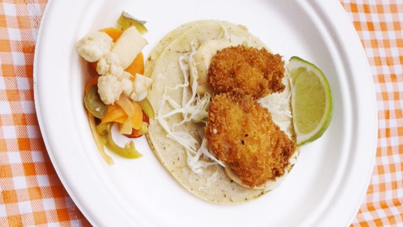 Japanese fried chicken taco with lime, slaw and pickled vegetables at Tacolicious