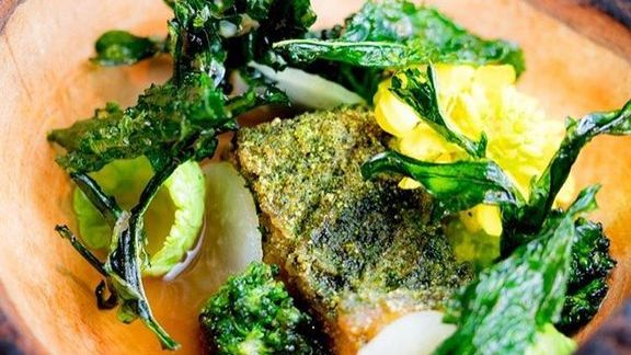 Wild striped bass, green garlic, baby brassicas, grilled-bone broth at Lazy Bear