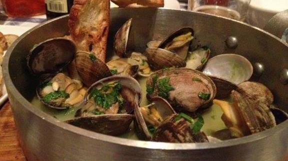 Chef Heidi Gibson reviews steamed clams at