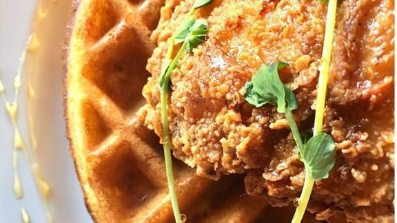 Chicken and waffle with bourbon syrup at Streetbird Rotisserie