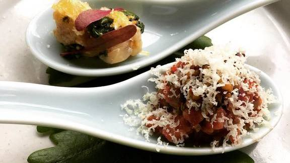 Madai with pickled ramps, beef tartare, brisket bark, mustard seed, and cheddar at Chroma Modern Bar + Kitchen