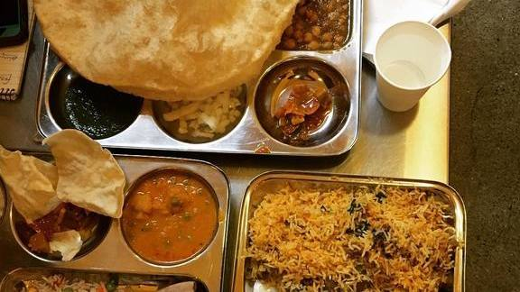 Two hour lunch feat. poori, daal, biryani, raita, tamarind and green chutney at Vik's Chaat Corner
