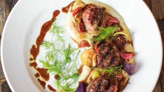 Chef Josh Niernberg reviews Colorado lamb tenderloin at Bin 707 Foodbar