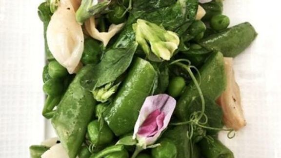 English and sugar snap peas, spring onions, ramps, mint, marjoram, pea tendrils and blossoms at CUT by Wolfgang Puck