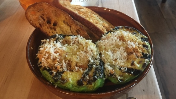 Grilled avocado crostini with pecorino cheese at Terrain Cafe