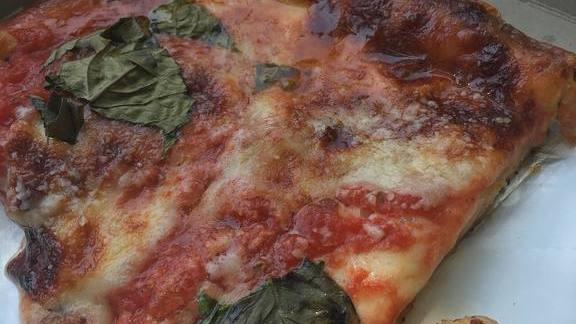 Square pizza with red sauce, basil and mozzarella cheese at Di Fara Pizza