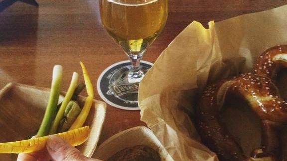 Kölsch beer, soft pretzel, pickles and mustard at Tabula Rasa