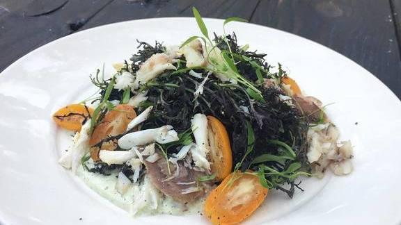 Higgins crab salad with chervil, scarlet frill, & kumquat buttermilk dressing at Boucherie