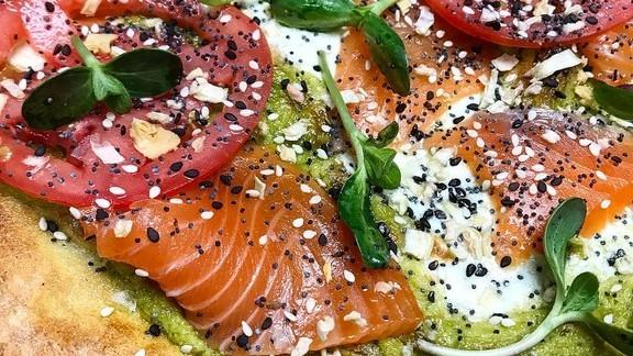 Brunch pizza; smoked salmon, avocado mascarpone, everything spice & sunflower at Rubirosa