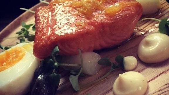 Salmon with fried egg aioli, lemon zest oil,  and asparagus at Chroma Modern Bar + Kitchen