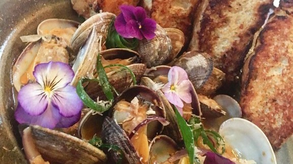Miso clams, homemade foccacia, edible flowers at Gannon's Restaurant