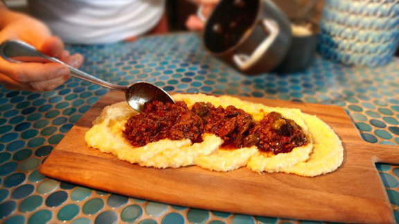 Chef Jason McLeod reviews Polenta board at Cucina Enoteca