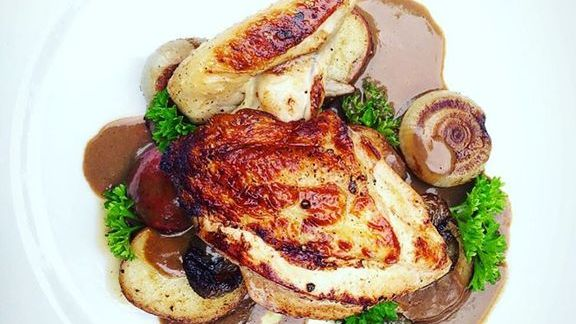 Roasted chicken with boozy liver sauce at Justine's Brasserie