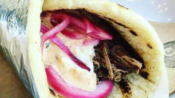 Chef Sammy Monsour reviews Braised beef flatbread with pickled onions at Preux & Proper
