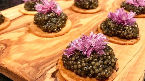 Caviar, caraway seed biscotti, chive blossom at Che Fico - COMING SOON