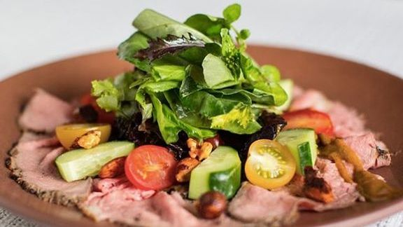 Roast beef, cucumber, tomato, Belgian endive, pickled portobello mushroom & basil salad, spiced nuts, galangal root dressing at Chambar