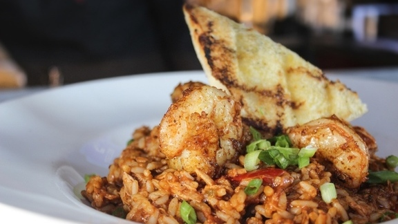 Chef Greg Baker reviews Jambalaya with chicken, tasso, andouille, and shrimp. at