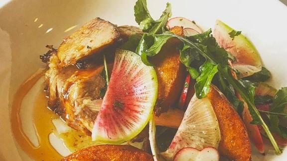 Pork with arugula, radishes, pickled rhubarb, and cornbread at Cafe Margot