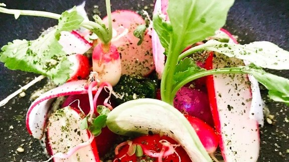 Kelp-compressed organic radishes, cultured nori butter, preserved radish greens and smoked nori salt at Lukshon