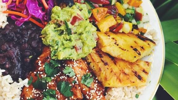 Coconut rice, guacamole, citrus slaw, mango cucumber salsa, pineapple, beans, and teriyaki chicken 😋😋😋 at Black Dolphin Inn
