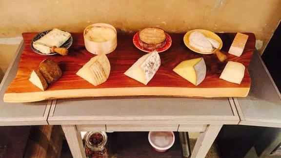 Cheese cart with Italian cheese selections from Piedmont, Tuscany, and more at Masseria