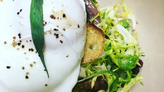 Chef Amalia Scatena reviews Salad Lyonnaise with ramp vinegar, poached egg, duck confit at The Restaurant at Cannon Green