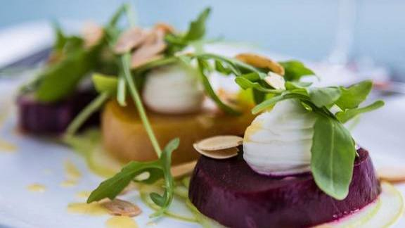 Chef Nguyet Nguyen reviews Roasted Beet Salad with whipped goat cheese and wild arugula at Hubbell & Hudson Bistro