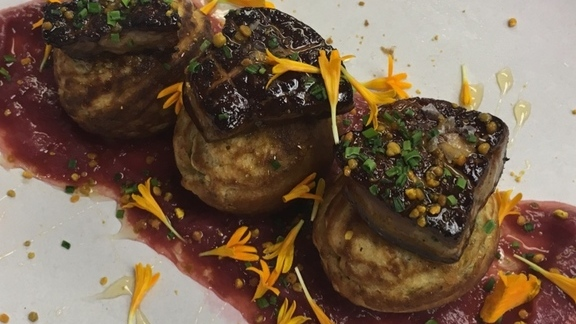 Seared foie gras, rhubarb compote, tarragon ebelskivers, marigold, rooftop honey at Urban Farmer