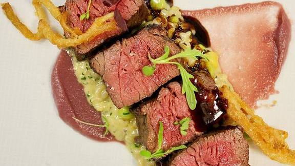 Chef Christopher Coombs reviews Prime beef spinalis, red onion jam, barley risotto, tempura ramps at Deuxave