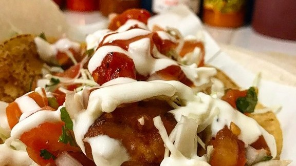 Killer fish tacos with tomatoes, cilantro, and crema at Los Tacos No.1