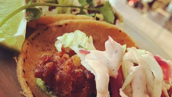 Tacos, Negro Modelo battered cod, pickled onions, chipotle crema at Lolinda