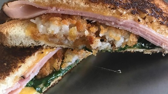 Ham and cheese sandwich with tater tots and spinach at The Grilled Cheese Truck
