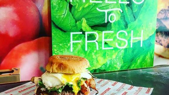 Breakfast burger with egg yolk and bacon at Good Stuff Eatery