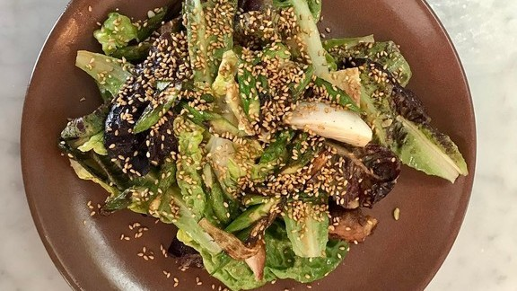 Great warm chicken salad with sesame dressing at Gioia Pizzeria