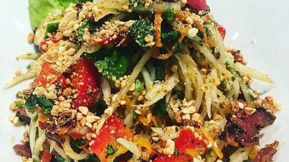 Papaya salad, candied bacon, mango,peanuts, and lime at Malai Thai Vietnamese Kitchen & Bar