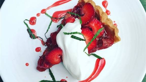 Strawberry rhubarb tart with rose petal ice cream and sliced mint at Lucques