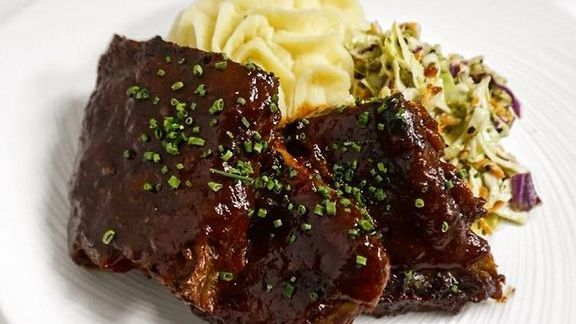 Chef Beverly Gannon reviews Baby back pork ribs, citrus BBQ sauce, slaw, butter whipped potatoes at Hali'imaile General Store