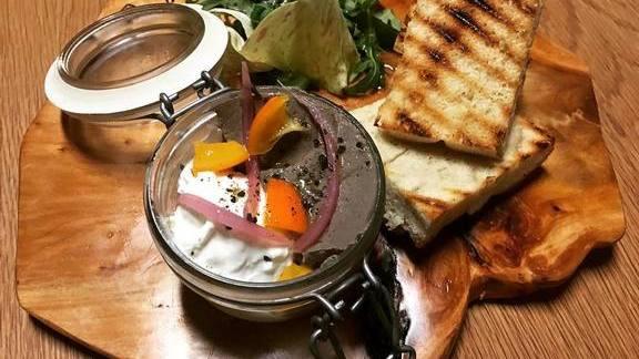 Chef Silvia Barban reviews Duck liver paté, stracciatella, kumquat confit, grilled focaccia at LaRina Pastificio & Vino