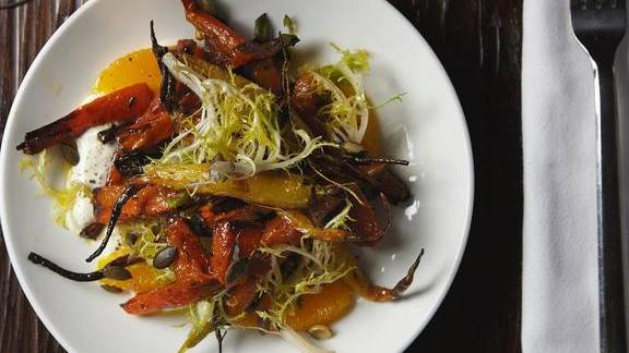 Chef Fernando Navas reviews Roasted carrots and frisee lettuce at Balvanera