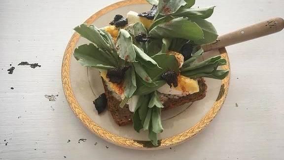 Fava leaf, soft-boiled egg and black olive smørbrød at MÅURICE