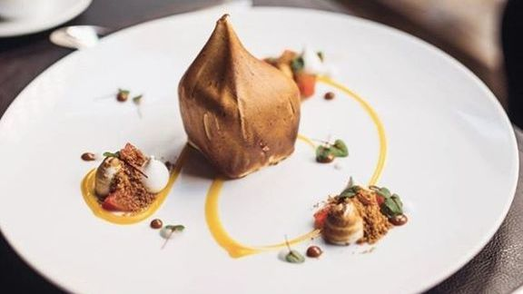 Dulce de leche ice cream, young coconut sorbet, micro sorrel, satsuma mandarin gel at CUT by Wolfgang Puck