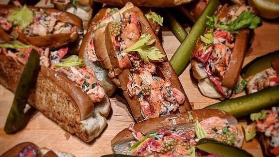 Lobster rolls, pickled cucumber, lemon at Le Kitchen